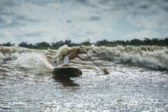 Robby Naish surfs a river tidal wave in Arari, Brazil on May 17th, 2014